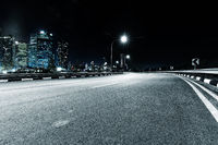nigh scene of empty road in modern city