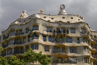 Facade of Casa Mila (La Pedrera) by Antoni Gaudi in Barcelona, Spain