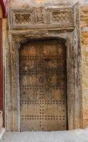 Old wooden door in medina of Fes