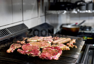 Assorted of a raw meat on the barbecue grill
