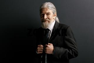 Stylish old man in black jacket.