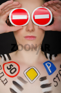 Beautiful woman with painted road signs