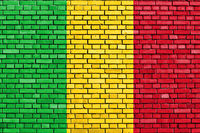 flag of Mali painted on brick wall