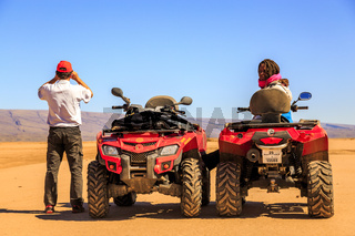 Ait Saoun, Morocco - February 22, 2016: Couple sitting in buggy car in desert