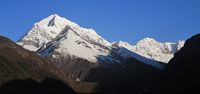 Snow capped Sunder Peak and other high mountains in Nepal. View from a place near Namche Bazaar.