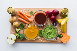vegetable puree or baby food in glass bowls