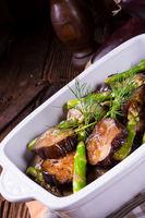 Eggplant casserole with green asparagus