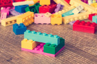 Toy bricks on the wooden surface