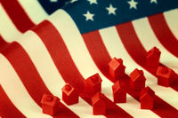 Mini houses against USA flag background