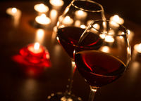 Two wineglasses in candlelight