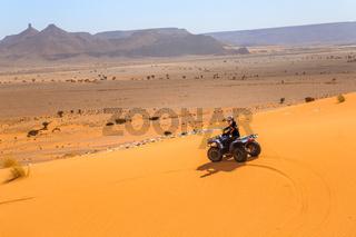 Merzouga, Morocco - February 26, 2016: Man riding buggy in desert.