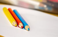 Colorful crayons on white paper