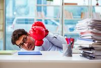 Businessman with boxing gloves in the office