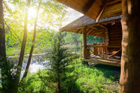 Wooden house and river