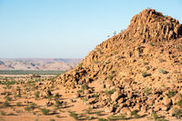 Rocky landscape of Namibia with huge boulders and green trees