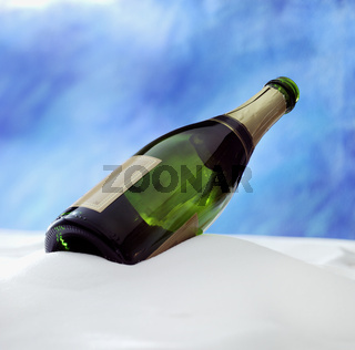 champagne bottle in the snow with