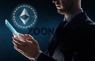 businessman with tablet pc and ethereum hologram