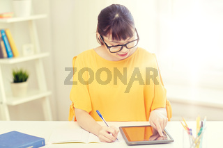 asian woman student with tablet pc at home