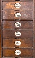 Old wooden filing cabinet with wooden drawers