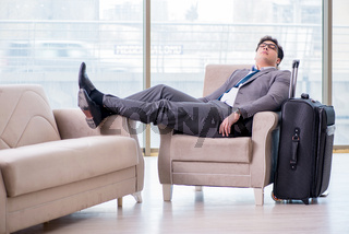 Young businessman in airport business lounge waiting for flight