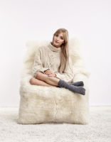 Blonde woman on furry arm-chair
