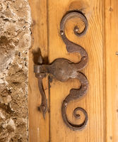 Old aged metal rusty metal door hinge