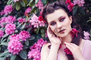 girl in dress in rhododendron garden