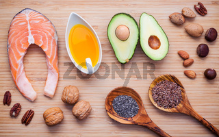 Selection food sources of omega 3 and unsaturated fats. Super food high vitamin e and dietary fiber for healthy food. Almond ,pecan ,hazelnuts,walnuts ,olive oil ,flax seed,chia ,avocado and salmon on bamboo cutting board.