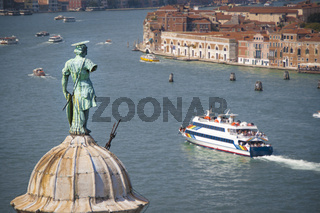 Aerial view of Venice lagoon and San Giorgio Maggiore dome with statue from the top of Campanile