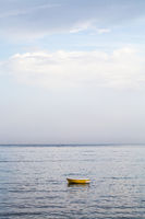 one yellow boat in Ionian sea near Giardini Naxos
