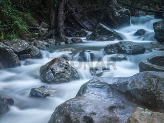 Fast flowing water of a mountain river