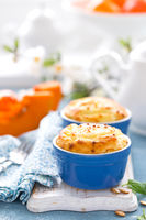 Delicious mini casserole with cottage cheese and pumpkin for breakfast. White background. Closeup