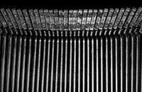 Macro detail of typescript inside electric typewriter