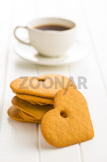 Gingerbread heart shape and coffee mug.