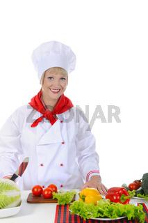 Happy Chef uniforms in preparing a healthy salad.
