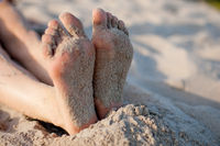 girl's feet on sand
