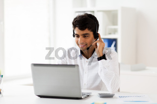 businessman with headset and laptop at office