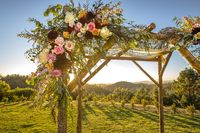 Jewish traditions wedding ceremony. Wedding canopy chuppah or huppah decorated with flowers
