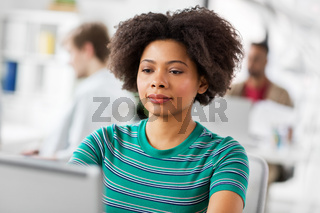 african woman with laptop computer at office