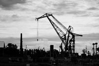 lifting crane for unloading and loading near the marina for ships in the Gulf of Finland. Black and white photo