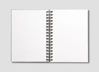 Blank open spiral notebook isolated on grey