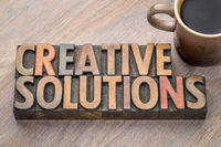 creative solutions word abstract in wood type