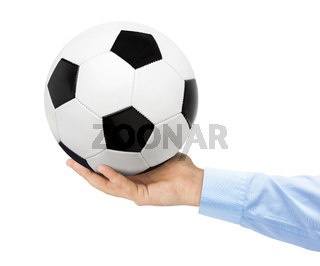 Hand and soccer ball