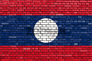 flag of Laos painted on brick wall