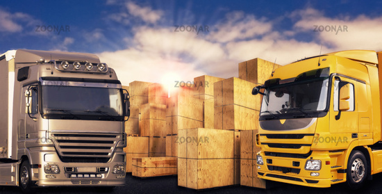 Zwei moderne LKW und viele Transportkisten