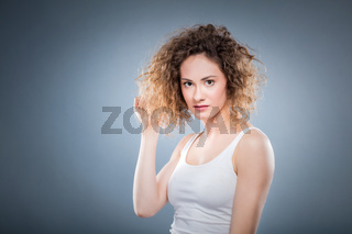 Portrait of a young girl with curly hair