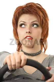 Portrait of the thoughtful woman at the wheel an autosimulator