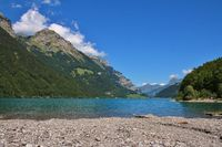 Beautiful place for swimming at lake Klontalersee, Switzerland. Summer scene in the Swiss Alps.