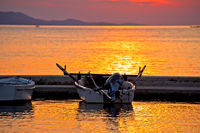 Old boat on golden sunset view