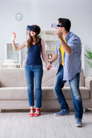 Young family playing games with virtual reality glasses